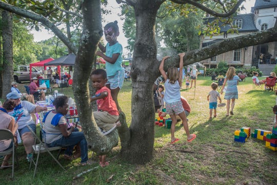 Children climb a tree during Shindig, a free concert and outdoor gathering that was also a fundraiser for Child Protect, Children's Advocacy Center, on July 29, 2018, at Montgomery's Winter Place in Historic Cottage Hill.