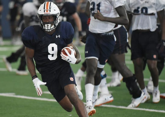 Auburn running back Kam Martin carries the ball during practice on Monday, Aug. 13, 2018 in Auburn, Ala.