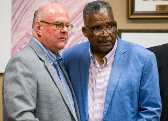 Board members W. Durden Dean, left and Robert Porterfield, right chat before a work session of the Montgomery School board in Montgomery, Ala. on Tuesday August 14, 2018.