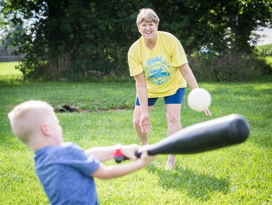 Tammy Moistner plays wiffle ball with her grandchildren at her home in Muncie.