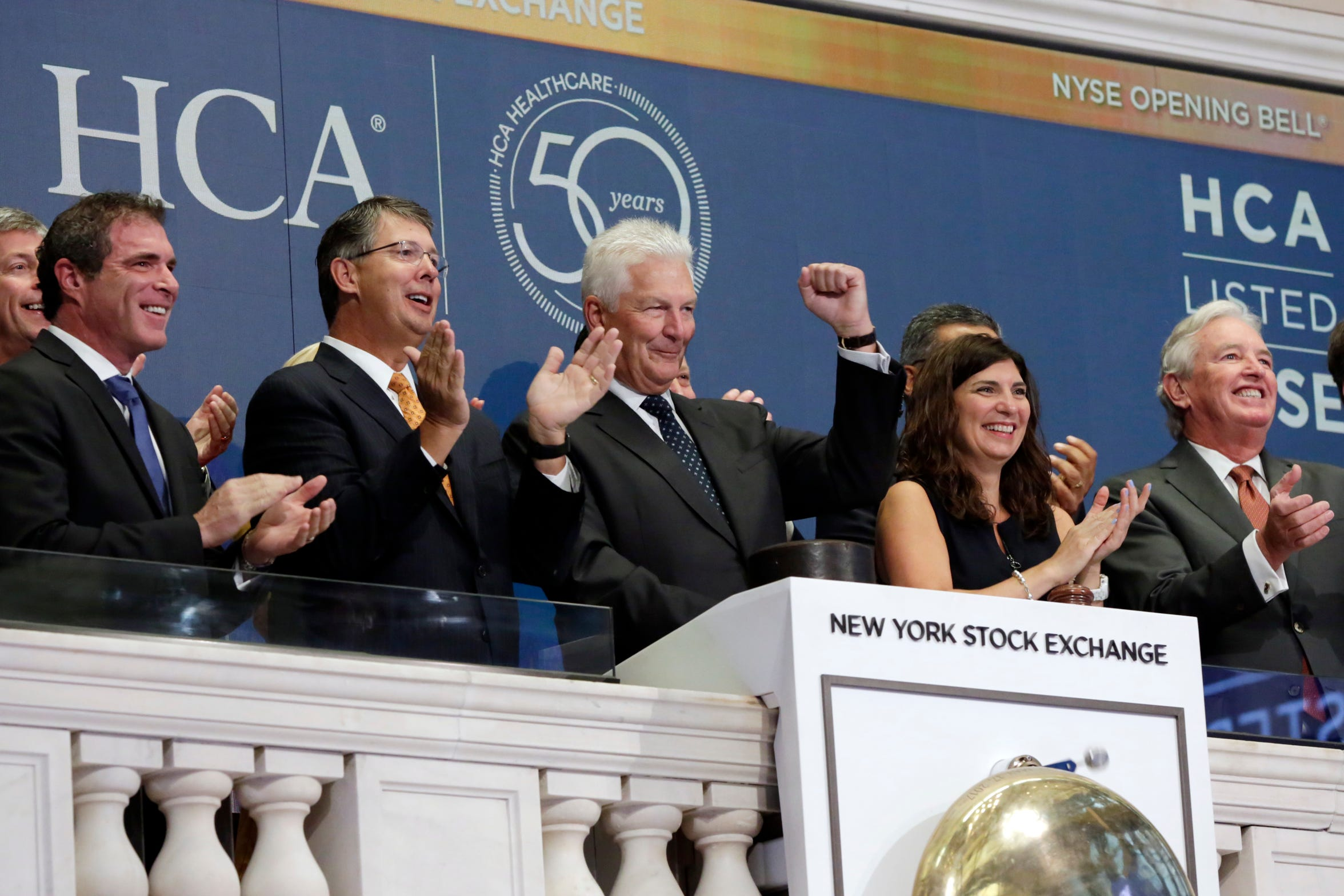 HCA Chairman and CEO Milton Johnson, center, company executives and NYSE President Stacey Cunningham applaud as Johnson rings the New York Stock Exchange opening bell Tuesday, Aug. 14, 2018, to celebrate 50 years since the company's founding.