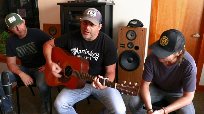 """Ben Hayslip, left, Rhett Akins, center, and Ross Copperman, right, co-wrote """"I Lived It"""" along with Ashley Gorley."""