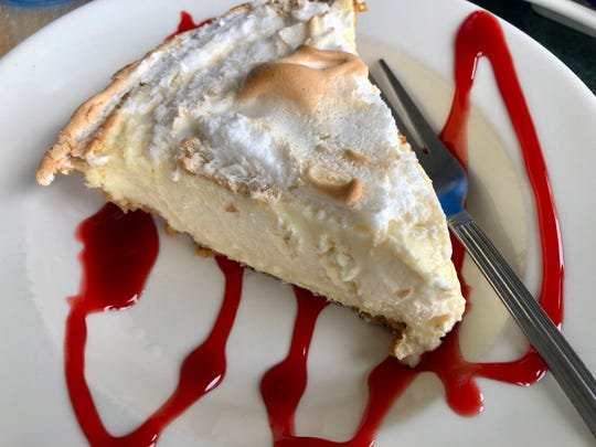 A slice of Key lime pie with strawberry drizzle from Crabby Lady Restaurant in Goodland.