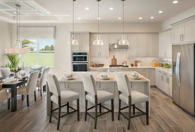 Azure at Hacienda Lakes is offering move-in ready coach homes with designer appointments and water views.