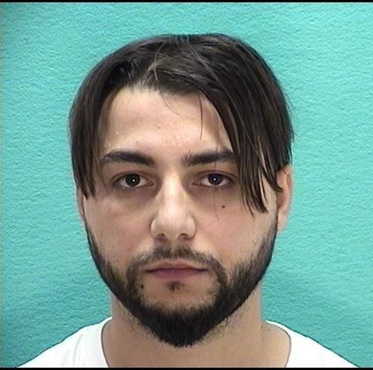 Nick Kvec was one of three men arrested for identity fraud after they were caught with multiple identifications.