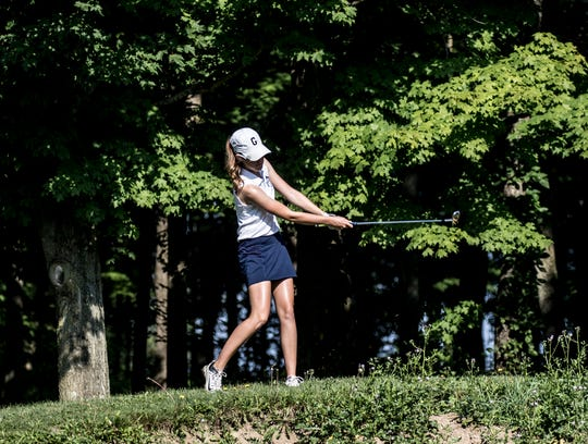 Granville's Alyssa Newsome hits a shot at the LCL girls golf tournament at Kyber Run Golf Course Tuesday.
