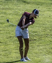 Licking Heights' Mariana Vega hits out of the fairway at the LCL girls golf tournament at Kyber Run Golf Course Tuesday.