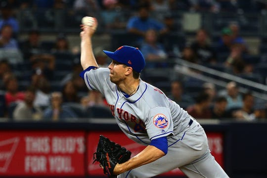 New York Mets starting pitcher Jacob deGrom (48) pitches against the New York Yankees during the third inning at Yankee Stadium.