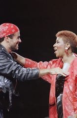 "Singing great Aretha Franklin joins George Michael on stage during his Faith World Tour in the Detroit area at the Palace of Auburn Hills, Aug. 30, 1988. The duo sang their Grammy-winning hit ""I Knew You Were Waiting."" (AP Photo/Rob Kozloff)"