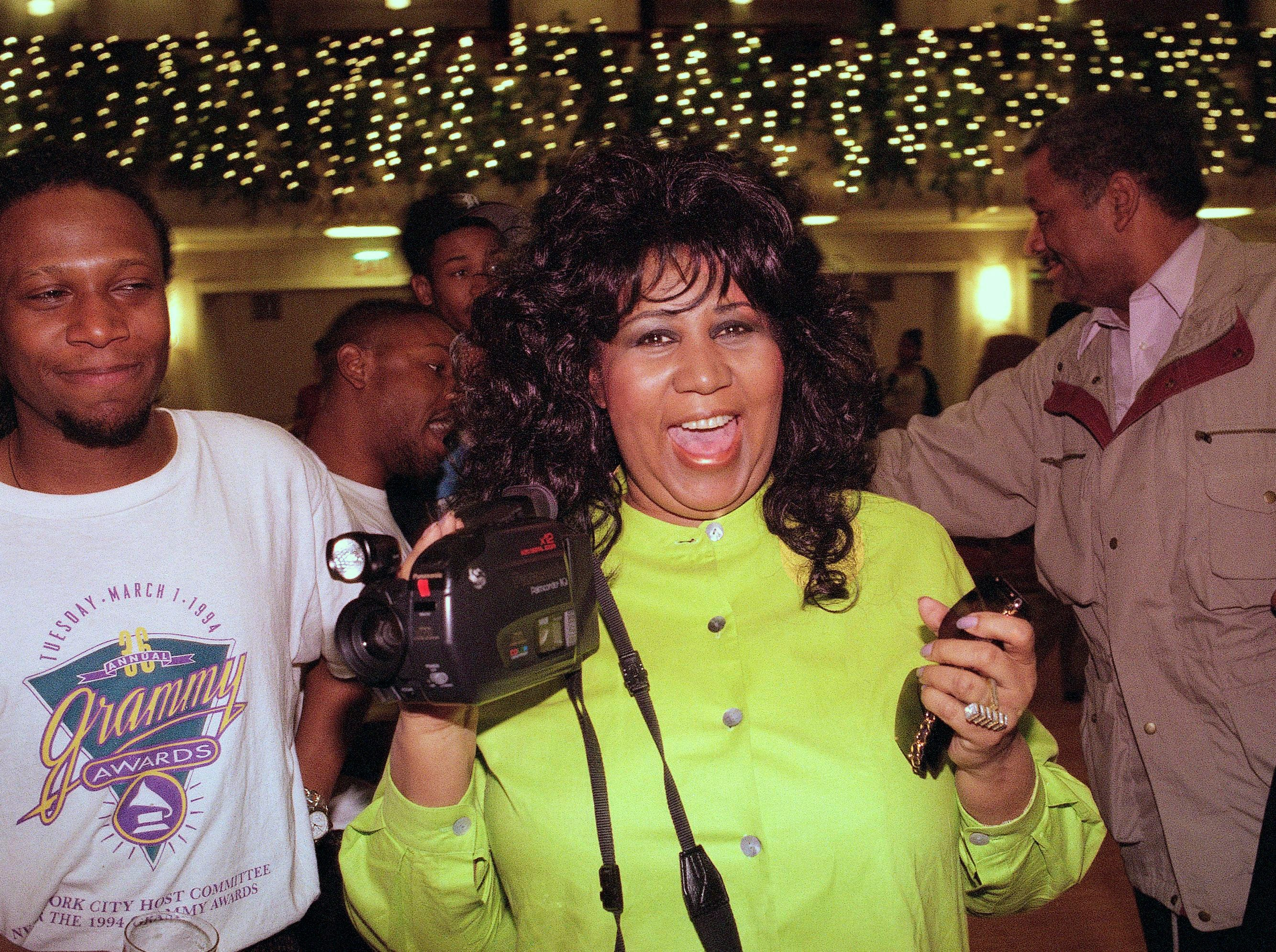 Aretha Franklin plays with a camcorder before a concert rehearsal in New York, April 27, 1995. Franklin's Thursday performance is to benefit New York City's Presbyterian Hospital's Sloane Hospital for Women. (AP Photo/Joe Tabacca)