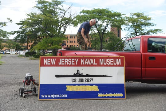 Jack Brown, a trustee of the NJ Naval Museum, home of the USS Ling (SS-297) loads items from the museum into the back of his truck with help from Navy veteran Kevin Koening of Hackensack. Brown served as a reservist on the Ling in 1970-1972 when it was docked in Bush Terminal in Brooklyn. Brown was removing items on Tuesday, August 14, 2018 the final day the museum had to vacate the property due to an eviction notice. The land on River St. has been sold.