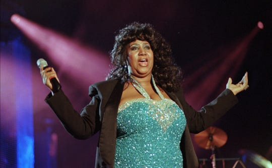 Soul singer Aretha Franklin finishes her set at the Concert for the Rock and Roll Hall of Fame in Cleveland, Saturday, Sep. 2, 1995. (AP Photo/Mark Duncan)