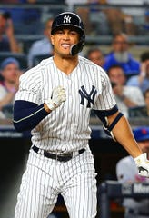 Yankees designated hitter Giancarlo Stanton (27) reacts after striking out against the New York Mets during the fifth inning at Yankee Stadium.