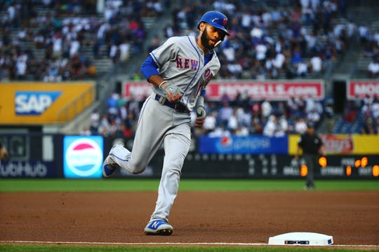 Mets shortstop Amed Rosario (1) rounds the bases after hitting a solo home run against the New York Yankees during the first inning at Yankee Stadium.