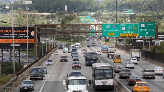 Traffic on the left is heading towards the Lincoln Tunnel while traffic on the right is heading west.  This photo, which was taken just before noon, shows relatively lite traffic compared to the bumper to bumper traffic that occurs during morning and evening rush hours on the bridge.