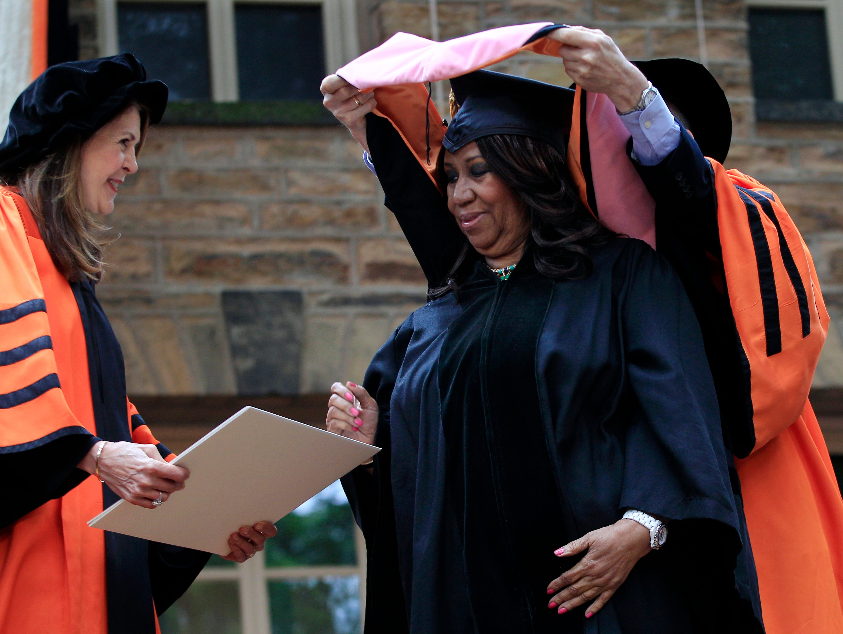 "Soul singer Aretha Franklin stands on stage at Princeton University in Princeton, N.J., Tuesday, June 5, 2012, as the ""Queen of Soul"" receives an honorary Doctorate of Music degree during Princeton University's commencement. Following Princeton tradition, the identity of the honorary degree recipients was kept secret until the morning of the Ivy League school's commencement."