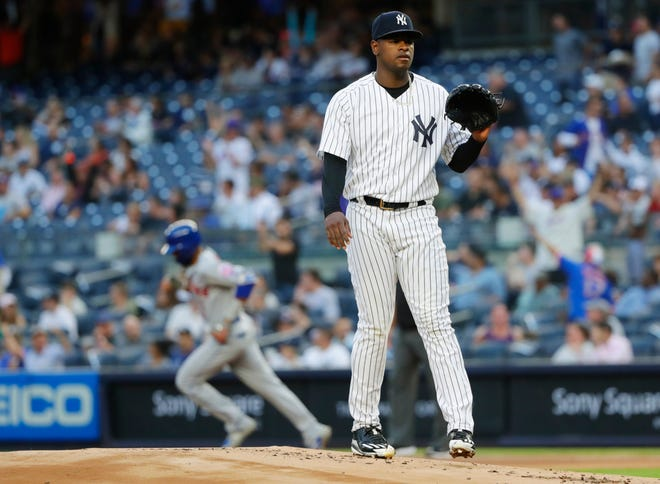 New York Yankees starting pitcher Luis Severino reacts as New York Mets' Amed Rosario runs the bases after hitting a home run during the first inning of a baseball game Monday, Aug. 13, 2018, in New York.