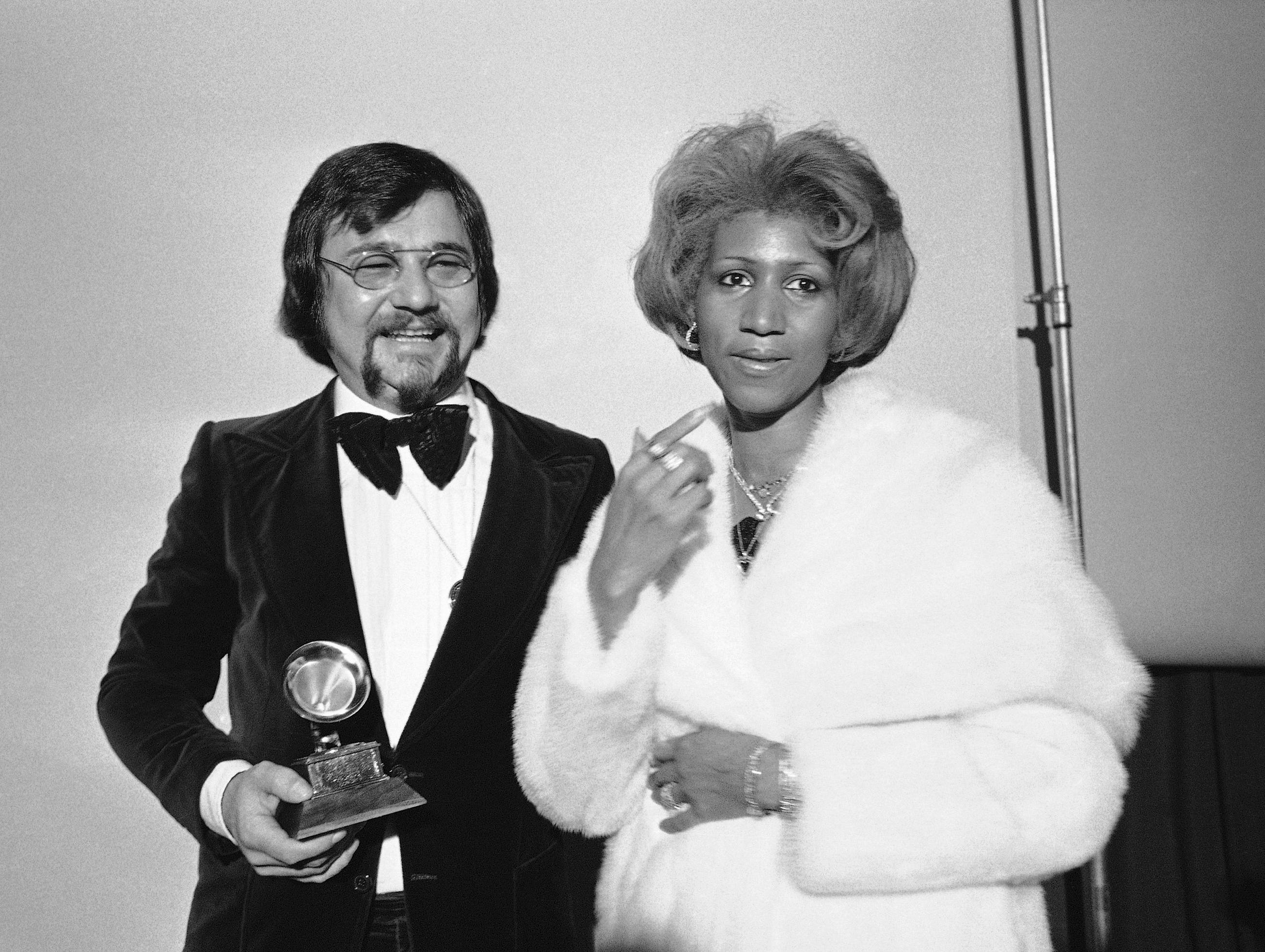 Sylvester Levay and Aretha Franklin,right, are shown at the Grammy Awards in Los Angeles, Feb. 28, 1976. (AP Photo)