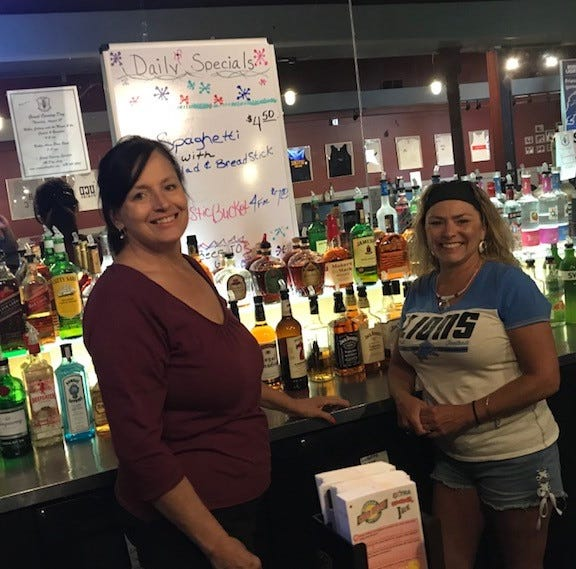 Carolyn Ciungan, daytime manager of Costas Village Bar in Wayne, and bartender Christie Shamba stand behind the bar and the newly renovated and reopened family bar.