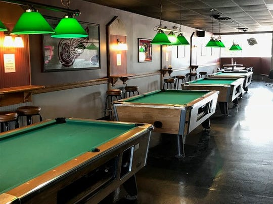 Pool tables line one side of the newly reopened Costas Village Bar in Wayne, owned by the family since the early 1950s.