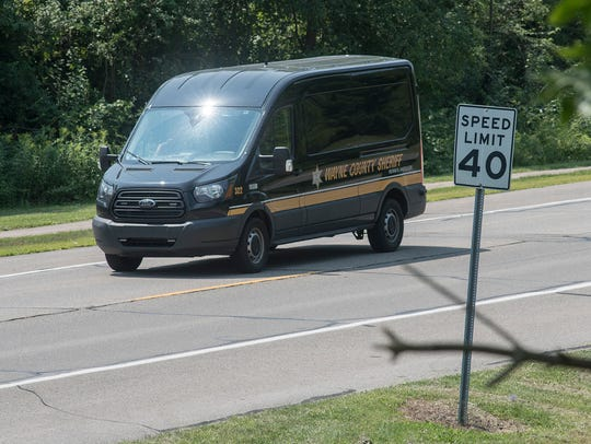 A Wayne County Sheriff vehicle heads to the scene.