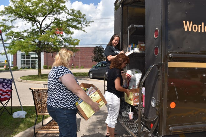 Organizers load donated items into the back of a UPS truck during a previous Stuff the Truck event. The Oshkosh Area United Way will host its 11th annual event Wednesday, Aug. 15, 2018, in the parking lot of Shopko, 1300 S. Koeller St.