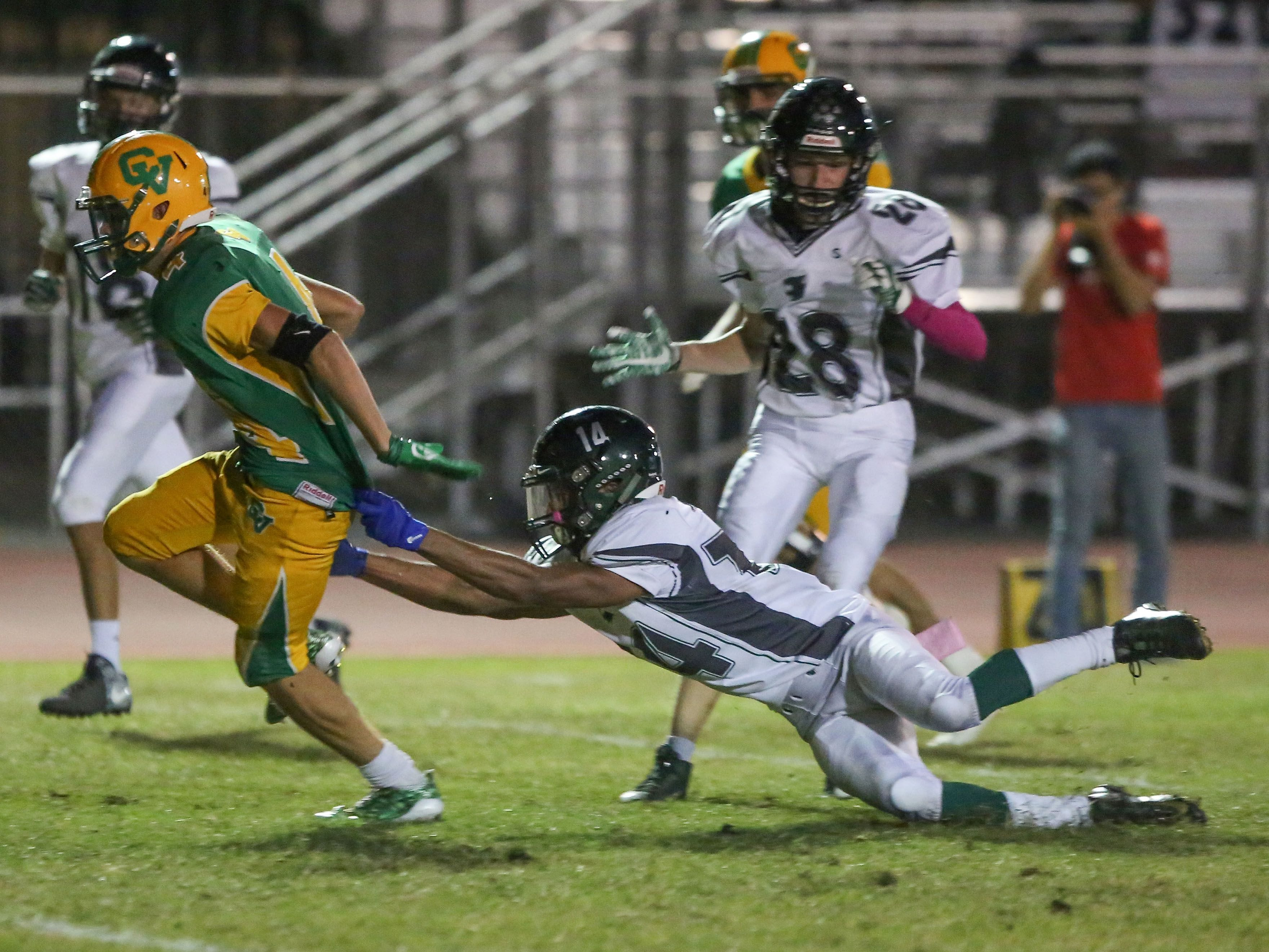 Coachella Valley receiver Angelo Fitzgerald breaks a tackle for a touchdown agasint Twentynine Palms, October 27, 2017.