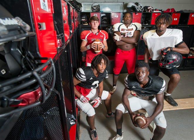 "Football players Trevor Jordan, clockwise from back left, Darius Washington, Keion ""KO"" Burrell, Keyshawn Swanson, and Amir McDaniel pose at West Florida High School in Pensacola on Tuesday, August `4, 2018."