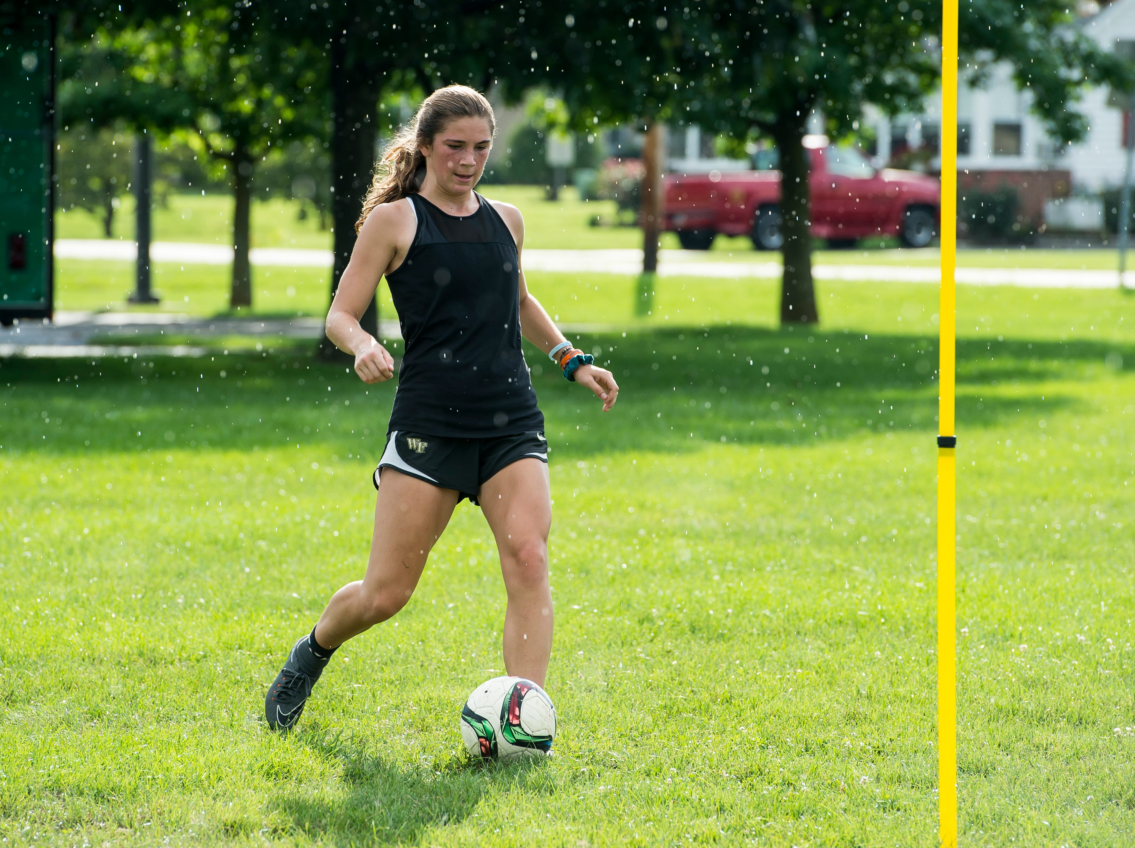 Fairfield junior Milly Heinbaugh works on a drill during the first day of fall sports practice on Monday, August 13, 2018.