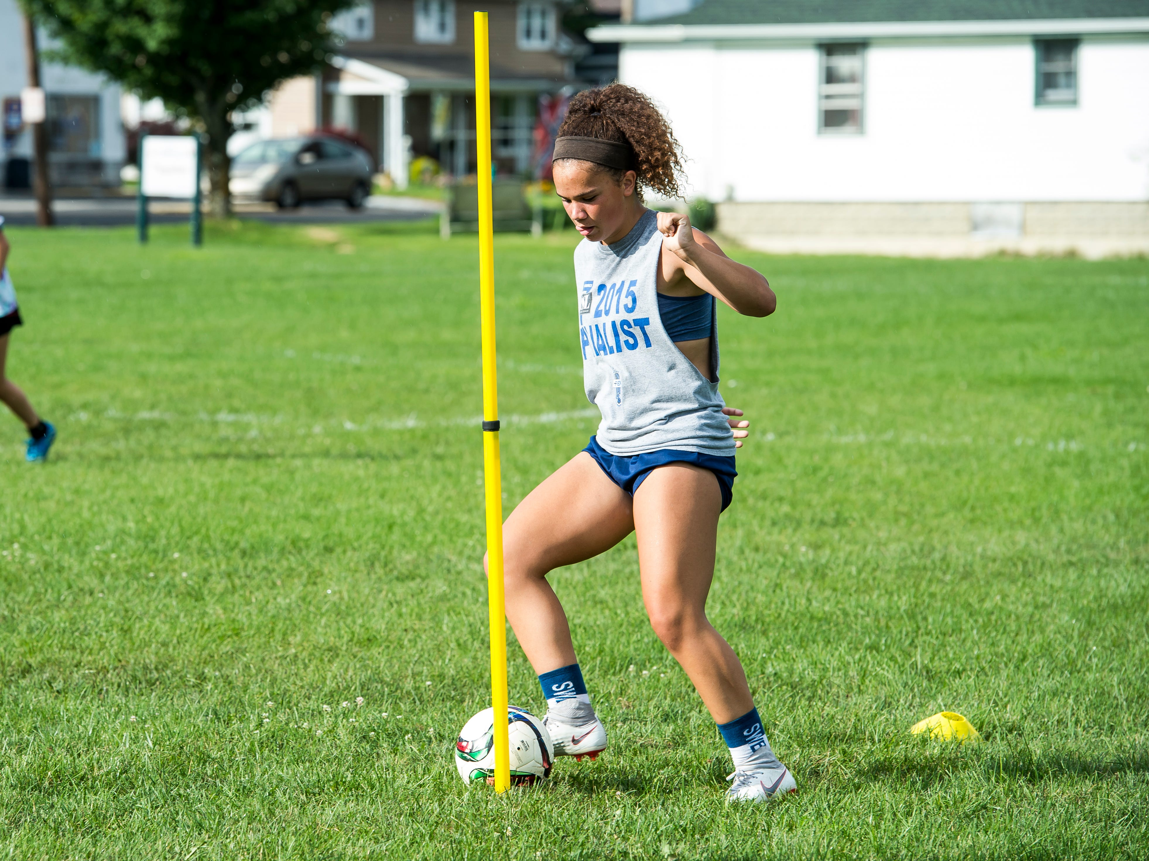 Fairfield junior Annabel Anderson works on a drill during the first day of fall sports practice on Monday, August 13, 2018.