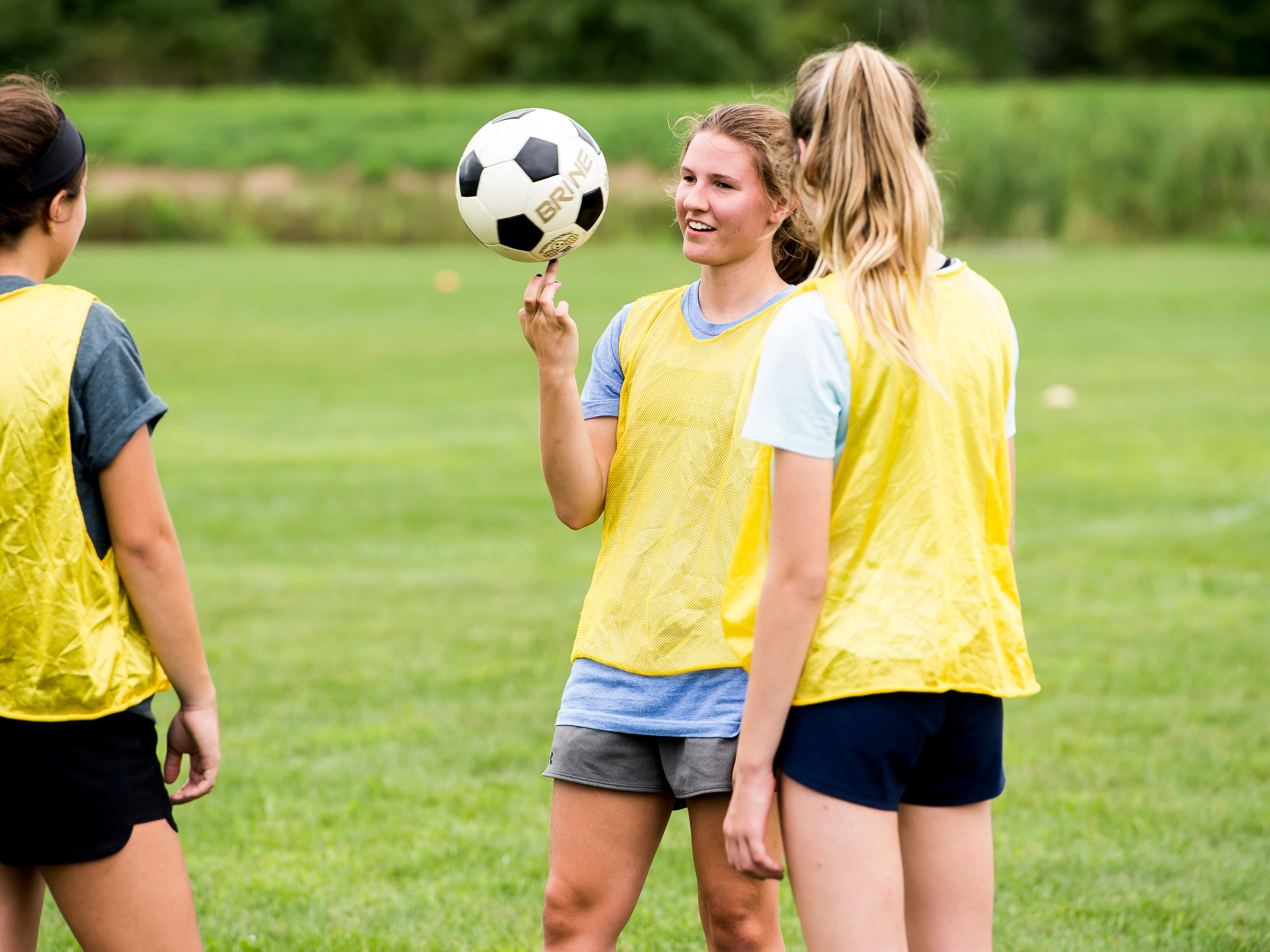 Gettysburg's Sam Shafer spins a soccer ball on her finger during the first day of fall sports practice on Monday, August 13, 2018.