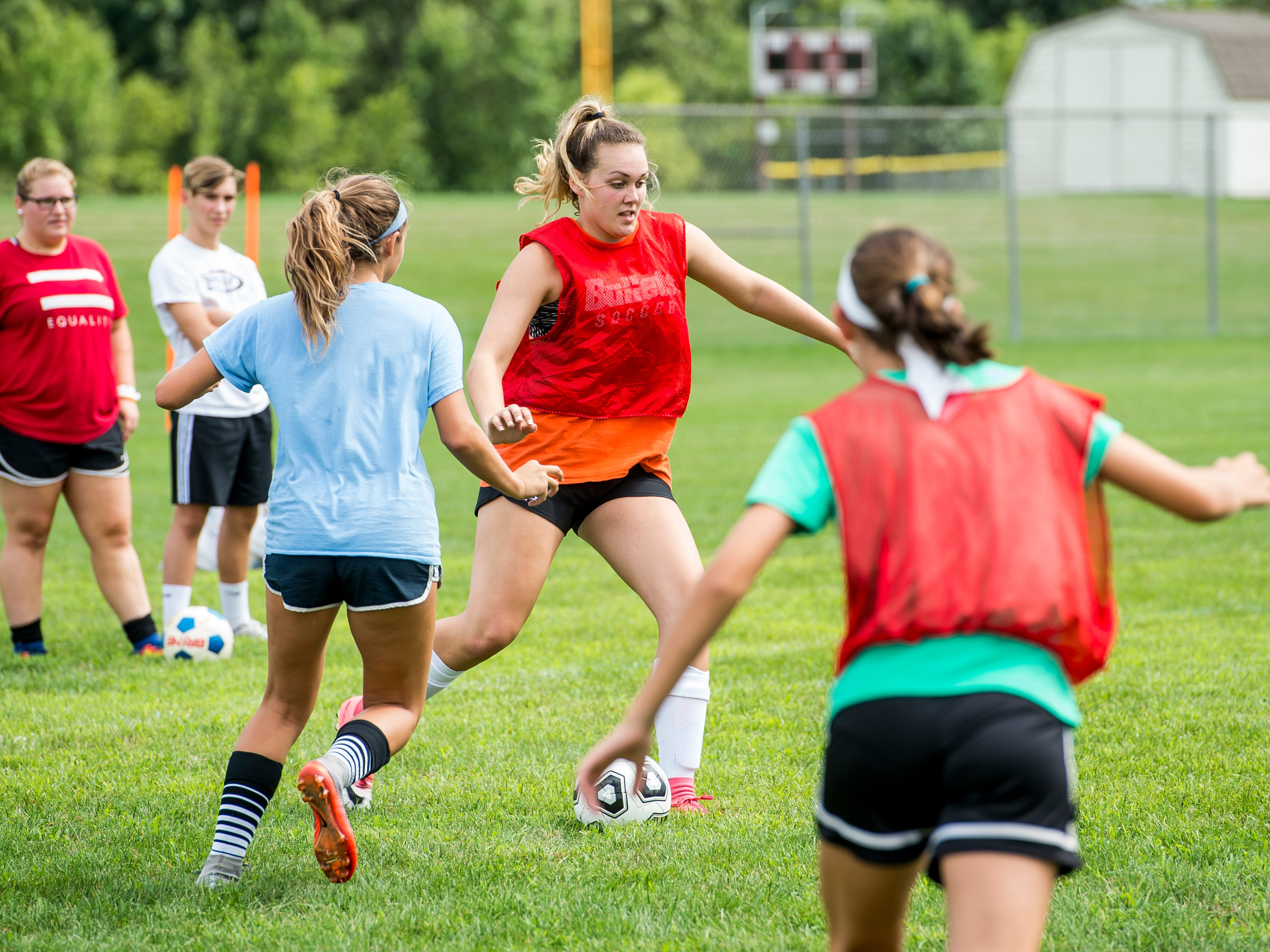 Gettysburg's Taylor Richardson kicks a soccer ball during the first day of fall sports practice on Monday, August 13, 2018.