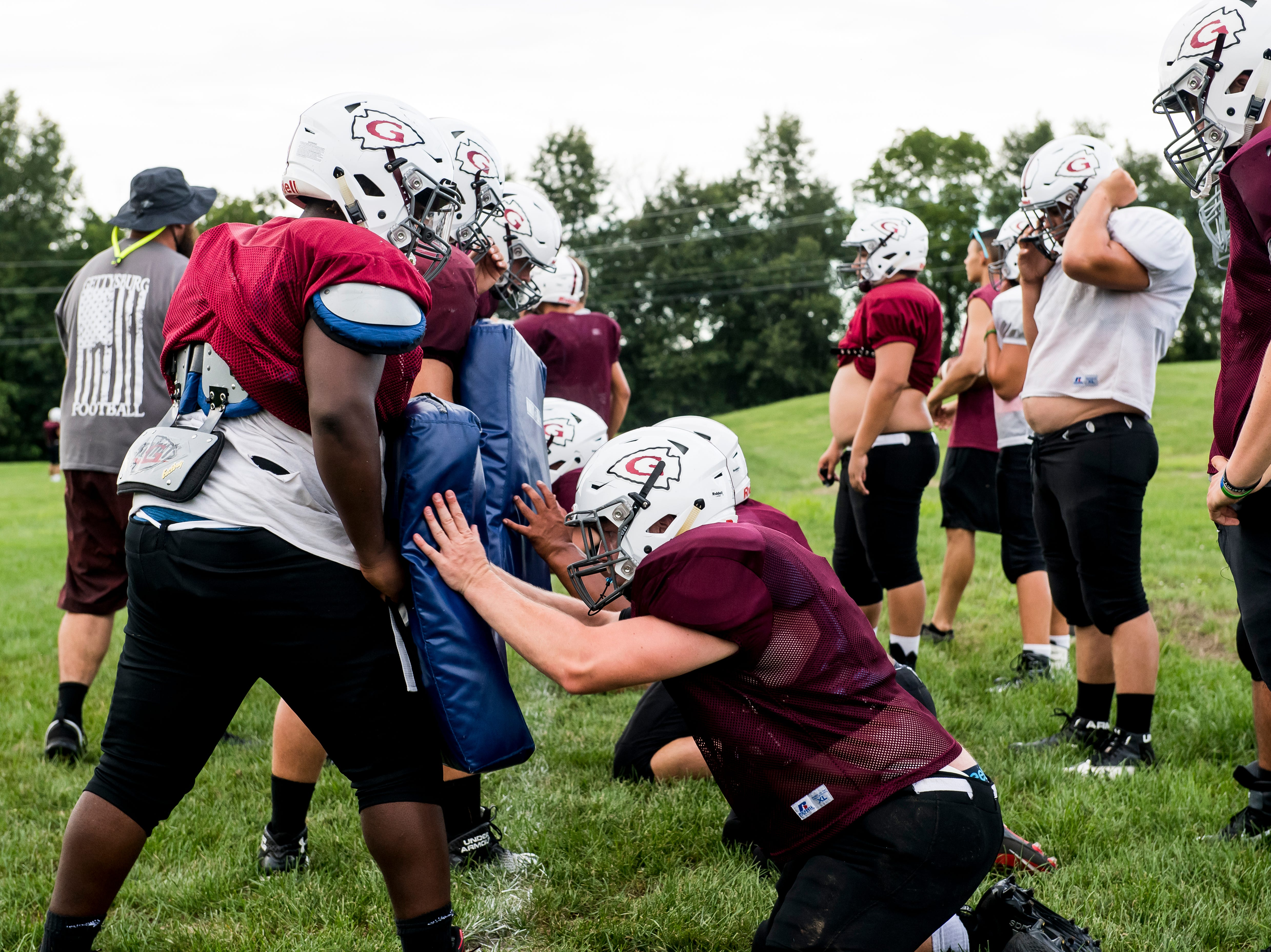 Gettysburg football players run through a drill during the first day of fall sports practice on Monday, August 13, 2018.