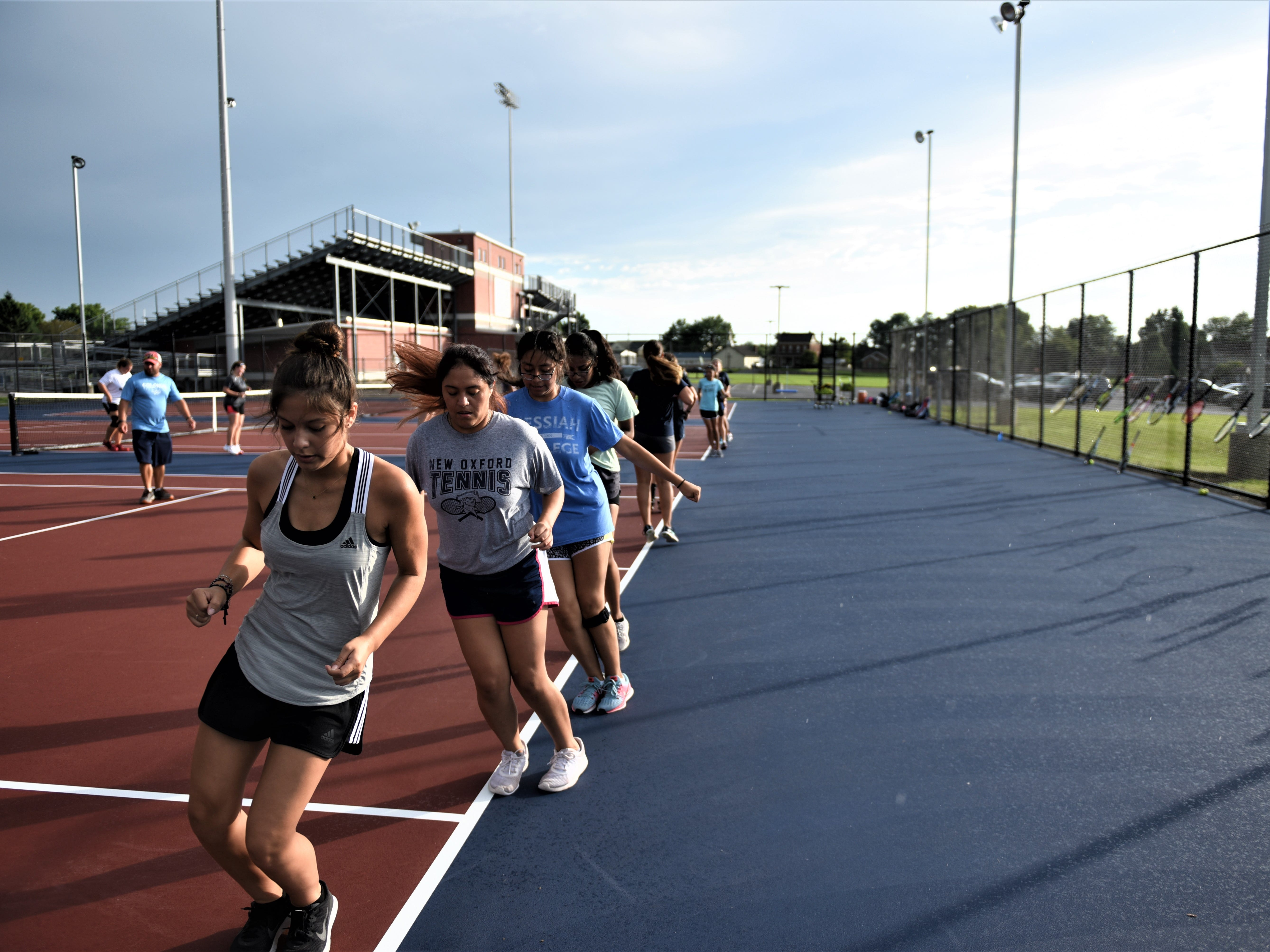 New Oxford tennis is working on their endurance the first day of practice, Aug. 14.
