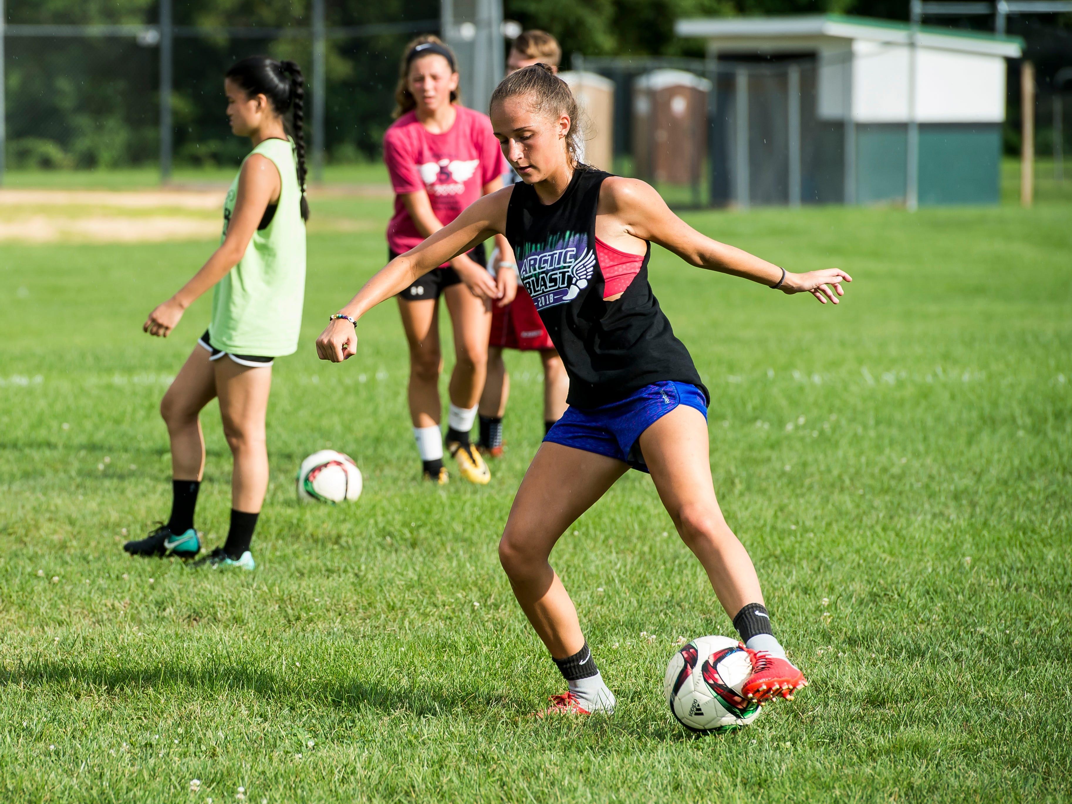Fairfield sophomore Rio Strosnider dribbles the ball during during the first day of fall sports practice on Monday, August 13, 2018.