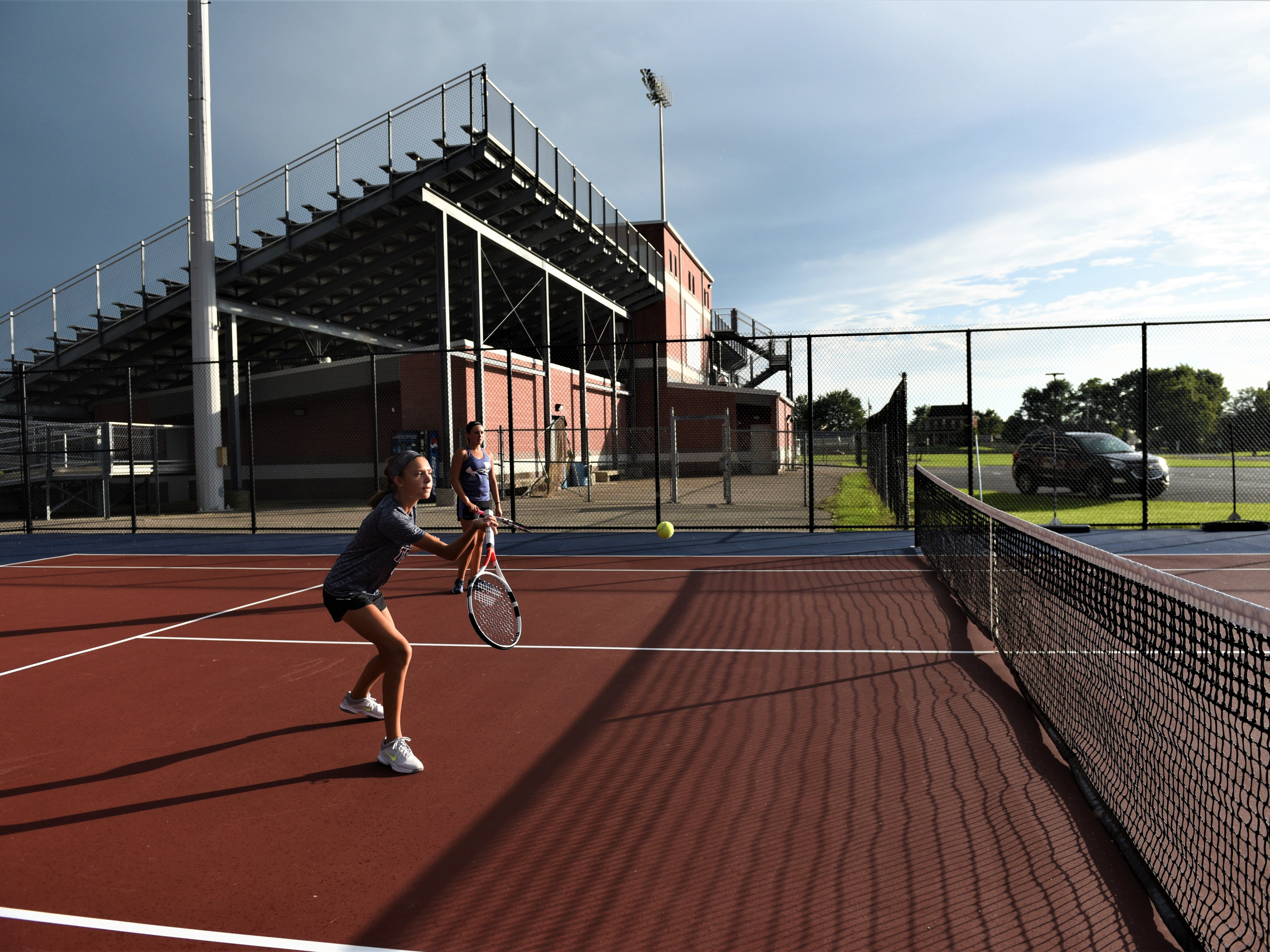 Sophomore, Kayla Hoffman, is warming up at New Oxford's first day of tennis practice on Aug. 14.
