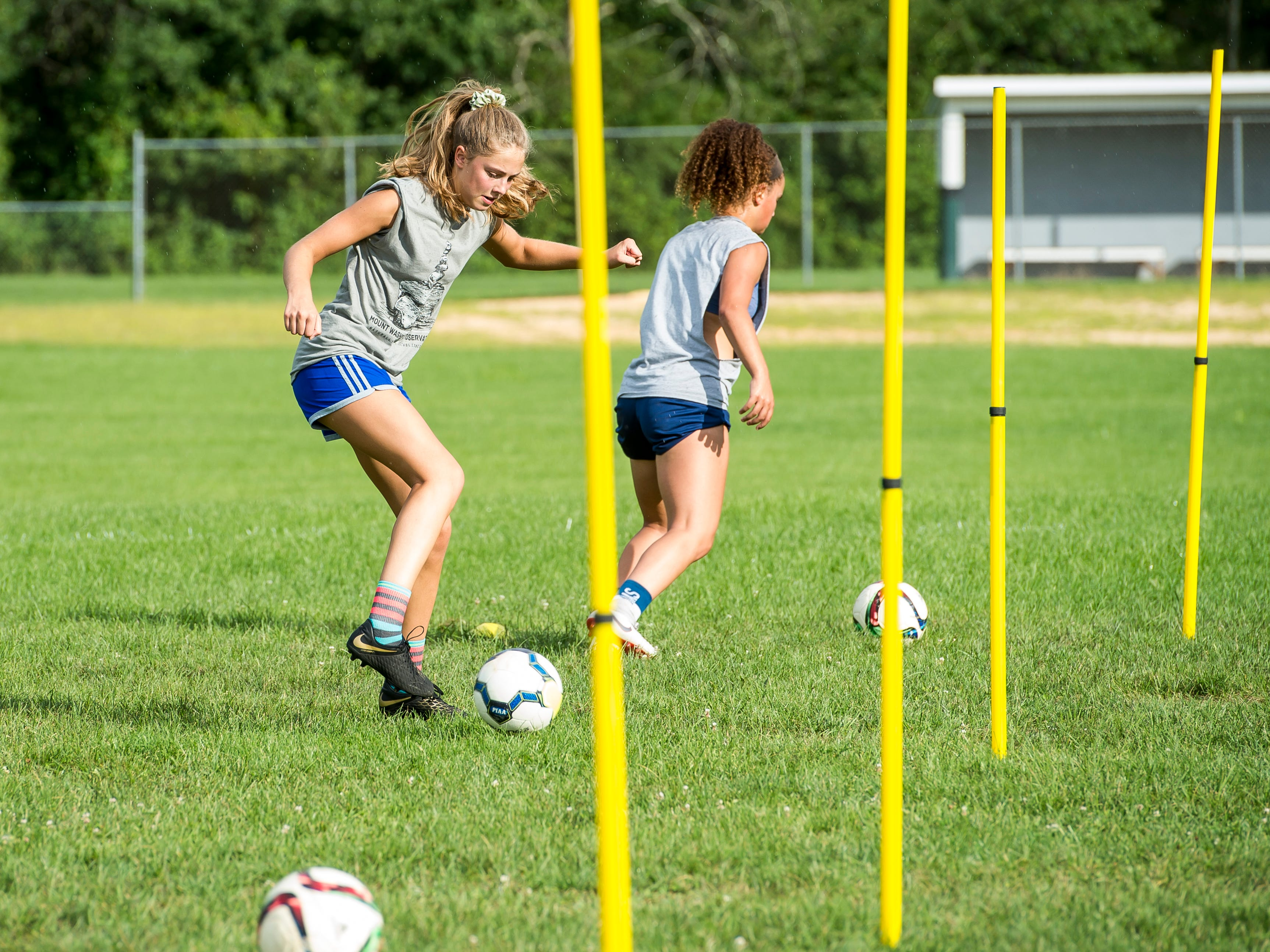Fairfield's Zoe Logue works on a foot drill during the first day of fall sports practice on Monday, August 13, 2018.