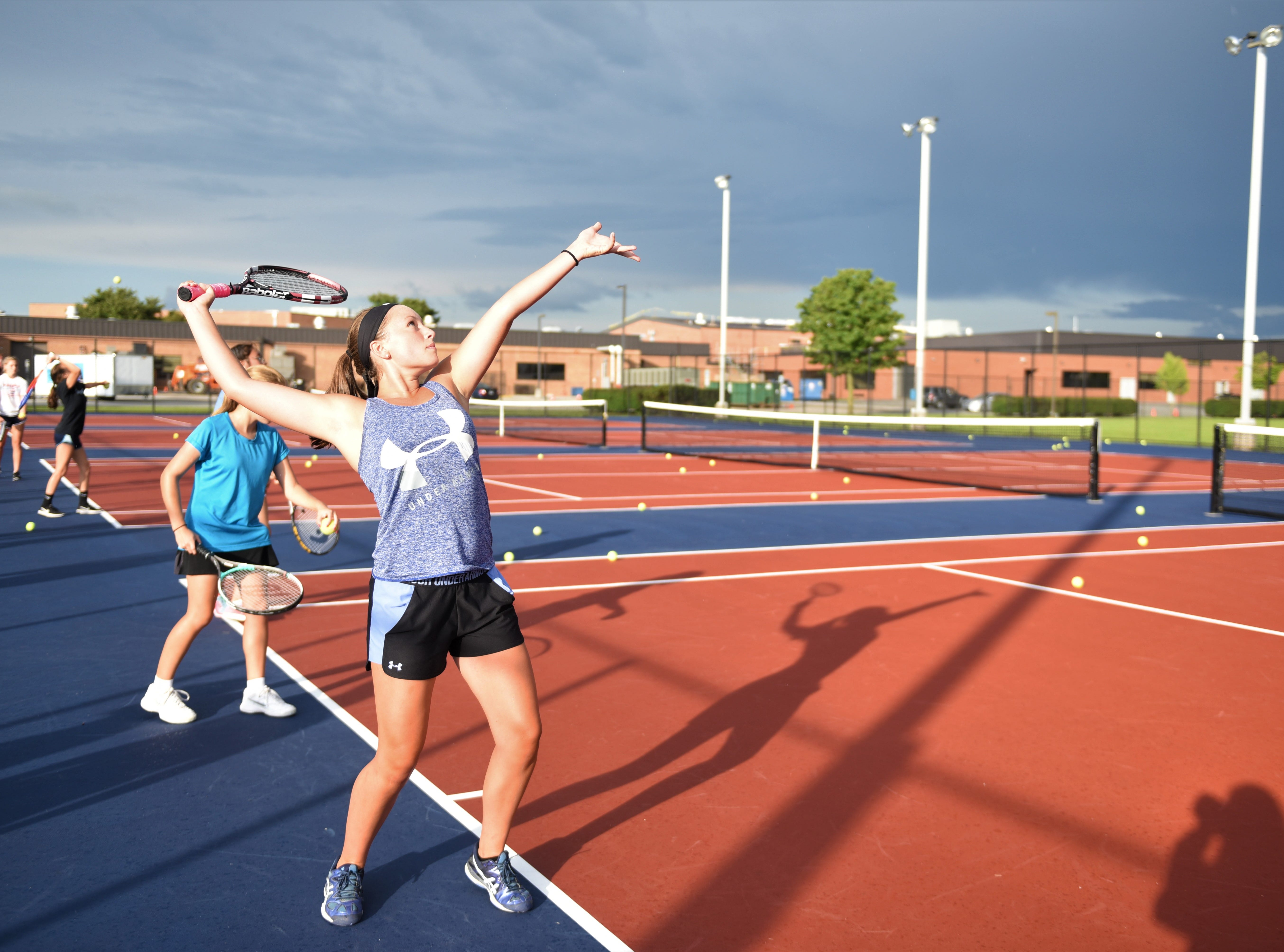 Kasi Conjack, New Oxford tennis junior, is practicing her serve on the first day of fall sports, Aug. 13.