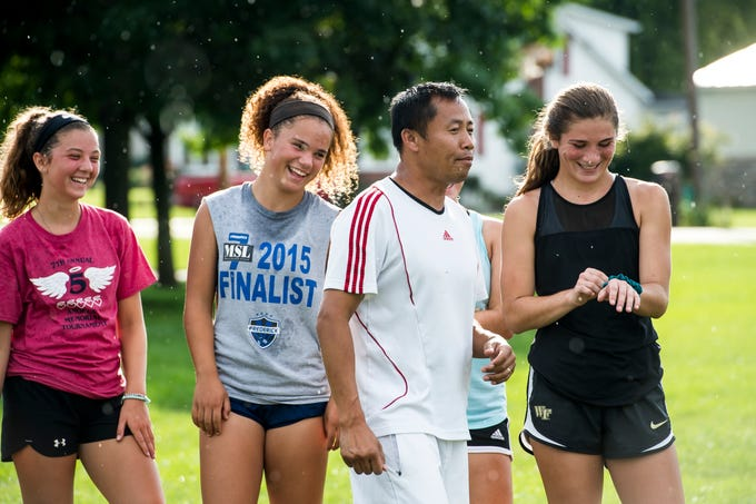 Fairfield girls soccer head coach Phomma Phanhthy makes his players laugh during the first day of fall sports practice on Monday, August 13, 2018.