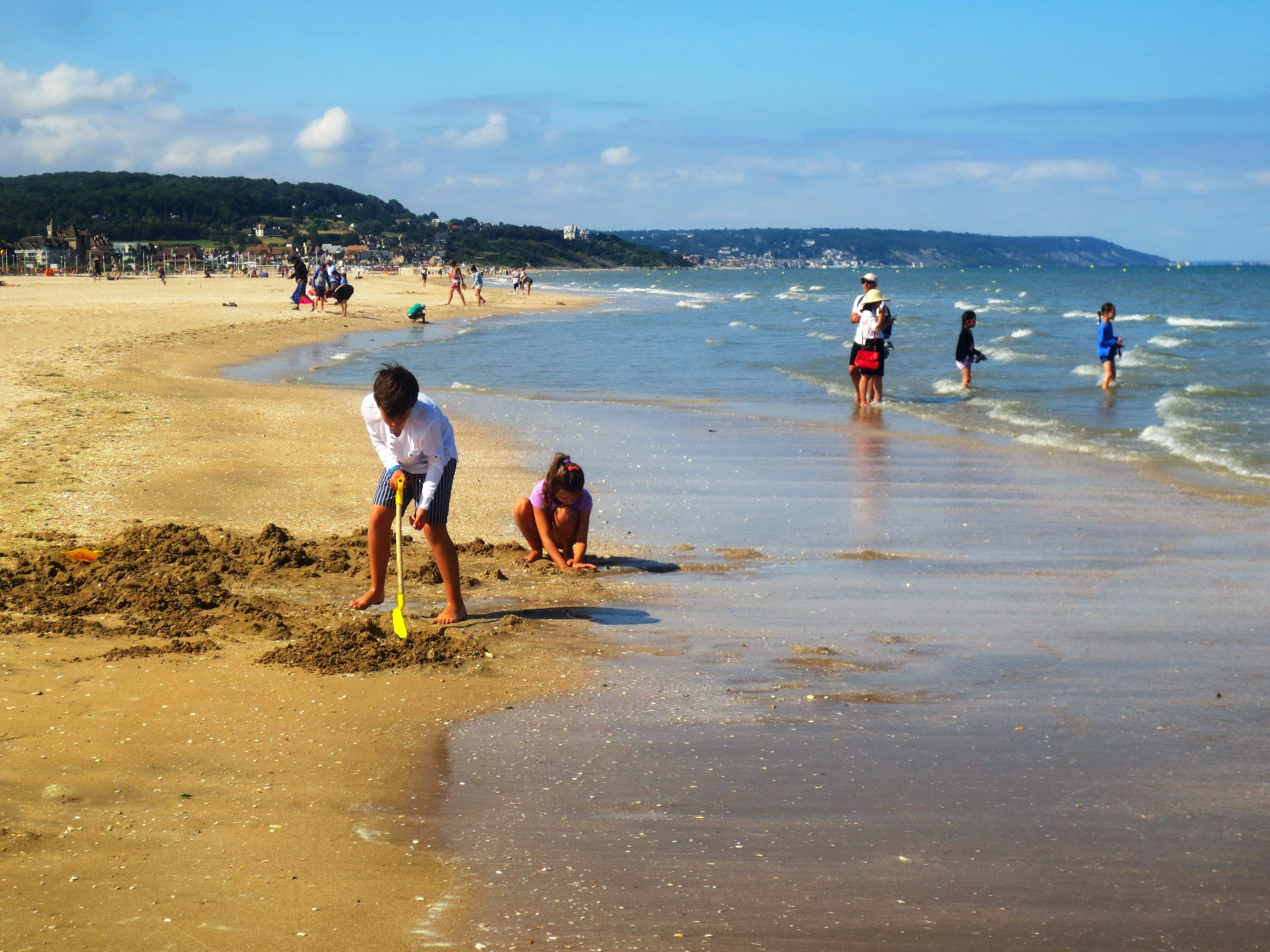 Children play on the beach in the resort town of Deauville, France, on the English Channel.