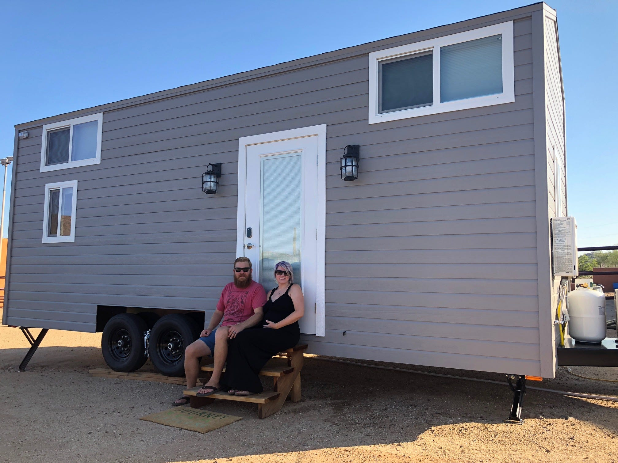 Justin and Rachel Beers in front of their tiny home.