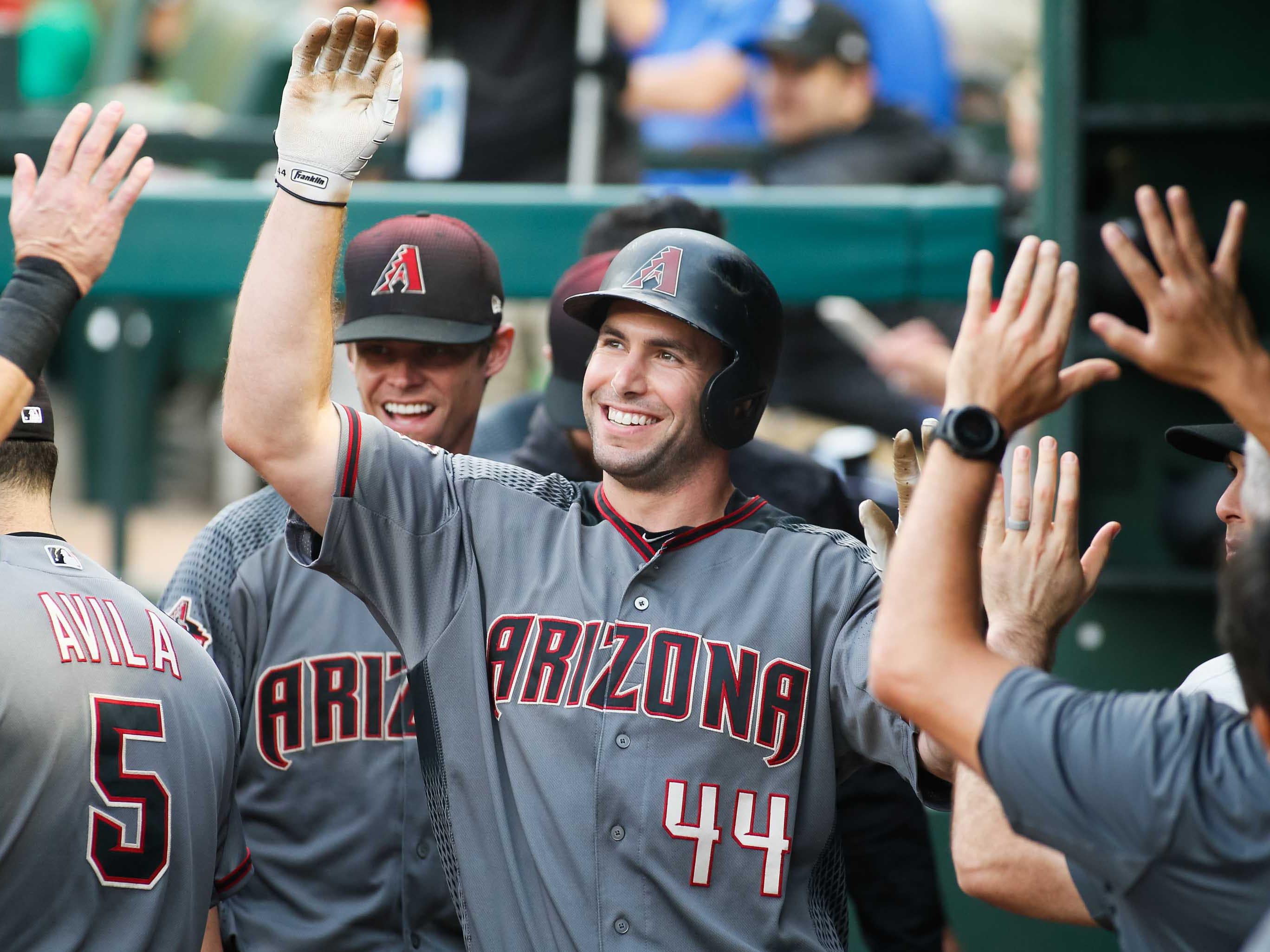 Aug 13, 2018; Arlington, TX, USA; Arizona Diamondbacks first baseman Paul Goldschmidt (44) is greeted in the dugout after scoring in the first inning against the Texas Rangers at Globe Life Park in Arlington. Mandatory Credit: Ray Carlin-USA TODAY Sports