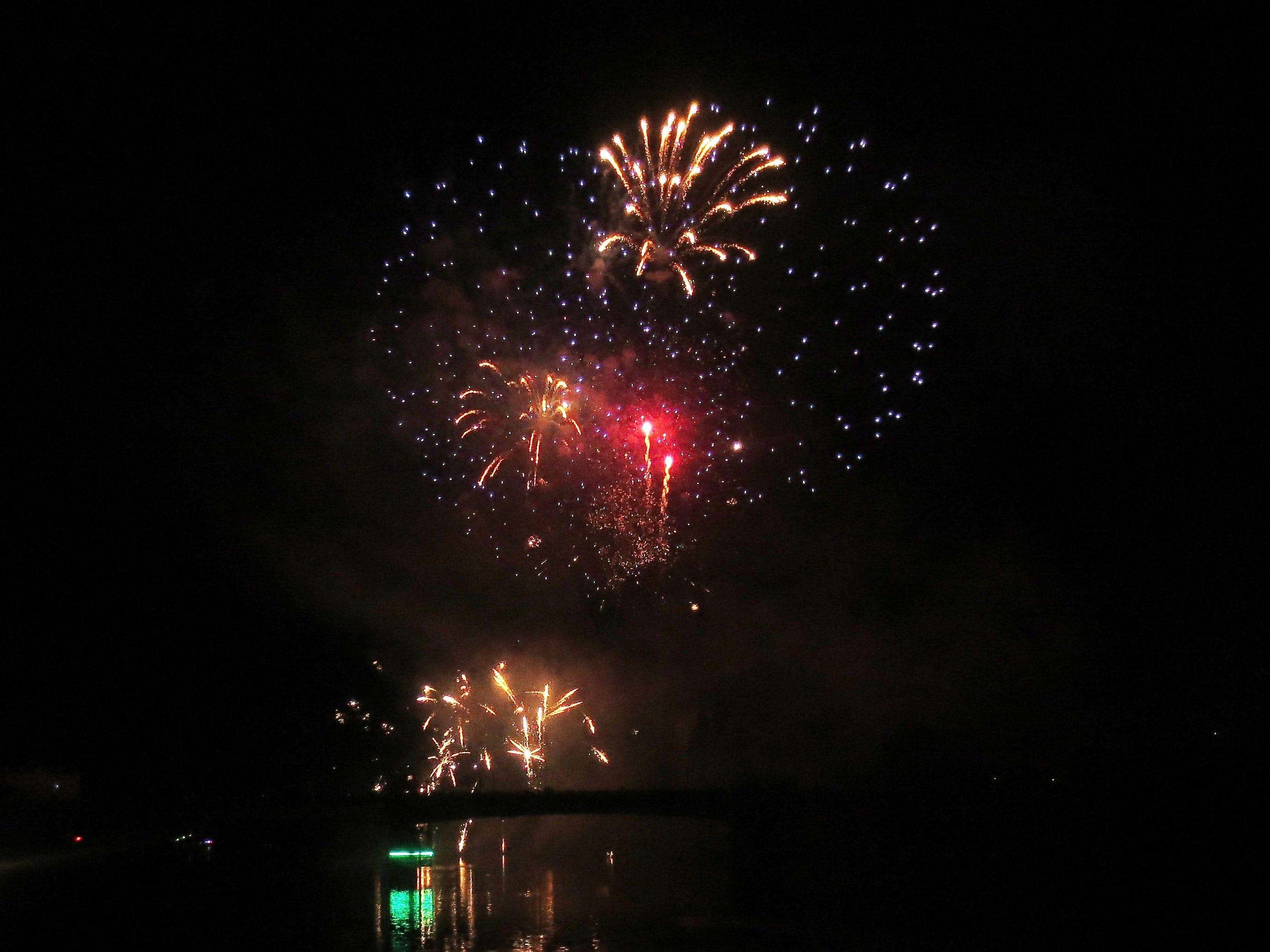 Bastille Day fireworks on the Seine River In northern France.