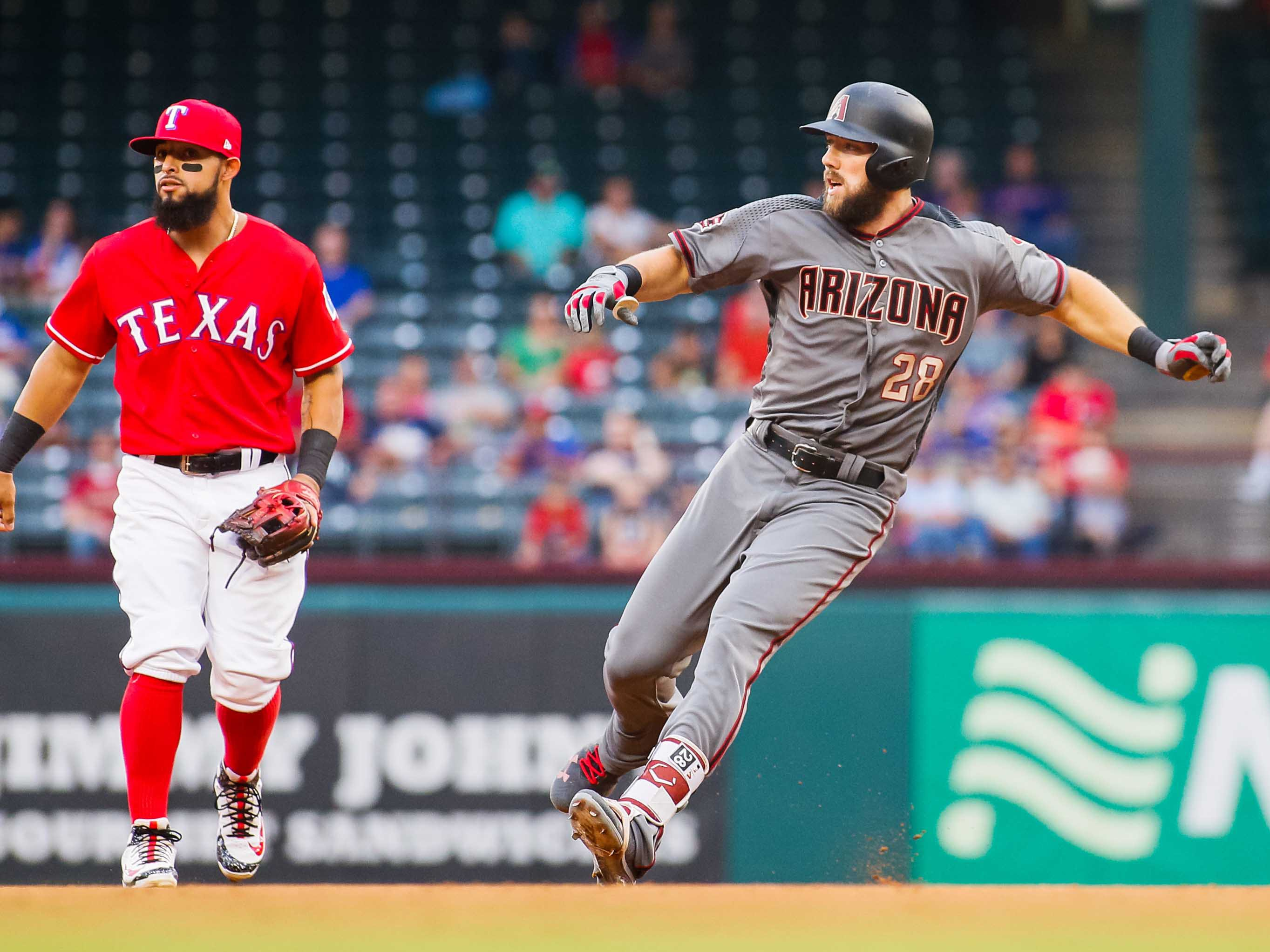 Aug 13, 2018; Arlington, TX, USA; Arizona Diamondbacks right fielder Steven Souza Jr. (28) rounds second base on a RBI double in the first inning as Texas Rangers second baseman Rougned Odor (12) looks on at Globe Life Park in Arlington. Mandatory Credit: Ray Carlin-USA TODAY Sports