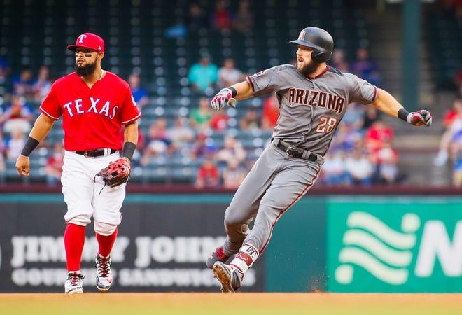 Aug 13, 2018; Arlington, TX, USA; Arizona Diamondbacks right fielder Steven Souza Jr. (28) rounds second base on a RBI double in the first inning as Texas Rangers second baseman Rougned Odor (12) looks on at Globe Life Park in Arlington. Mandatory Credit: Ray Carlin-USA TODAY Sports