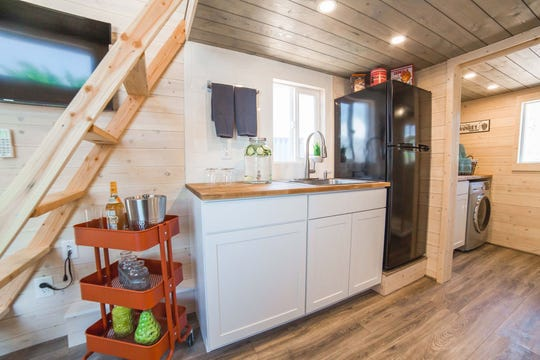 The kitchen and laundry spaces in the Beers' tiny home.