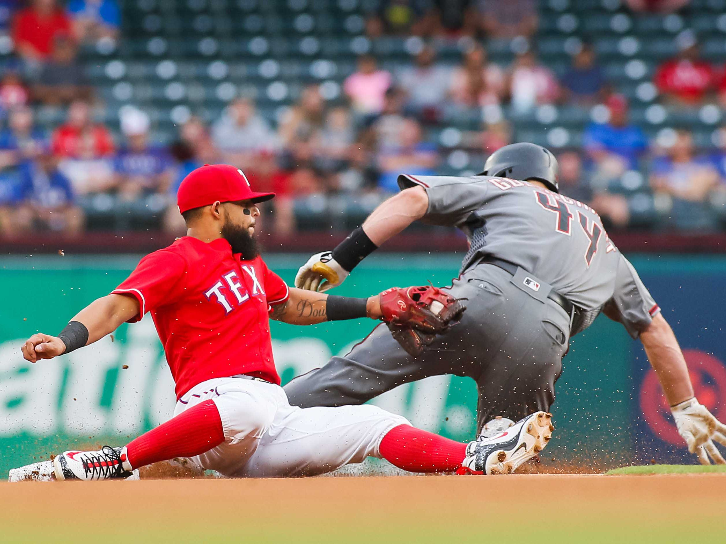 Aug 13, 2018; Arlington, TX, USA; Arizona Diamondbacks first baseman Paul Goldschmidt (44) steals second base as he slides under the tag of Texas Rangers second baseman Rougned Odor (12) in the first inning at Globe Life Park in Arlington. Mandatory Credit: Ray Carlin-USA TODAY Sports