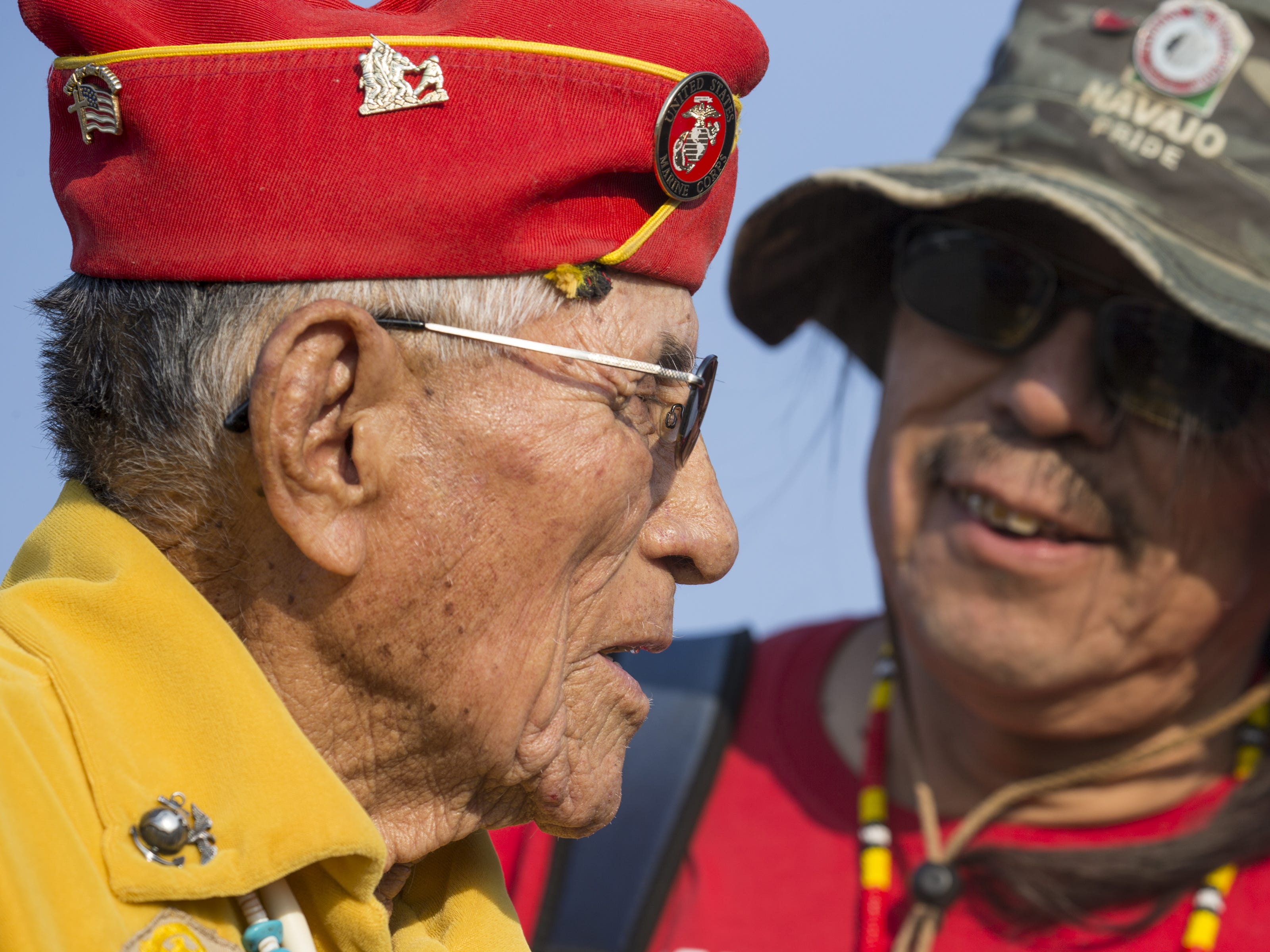 Navajo Code Talker John Kinsel, Sr. is greeted by his grandson, Rick Hoskie (right), while they wait for the start of the Navajo Nation Code Talkers Day parade on Aug. 14, 2018, at the Navajo Nation Fairgrounds in Window Rock.