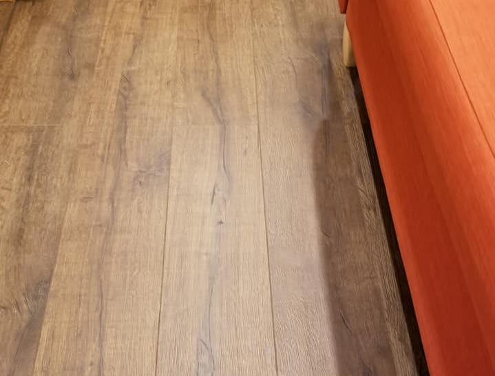 Upgraded Pergo vinyl flooring chosen for this tiny home, but the possibilities and upgrades in flooring are abundant.