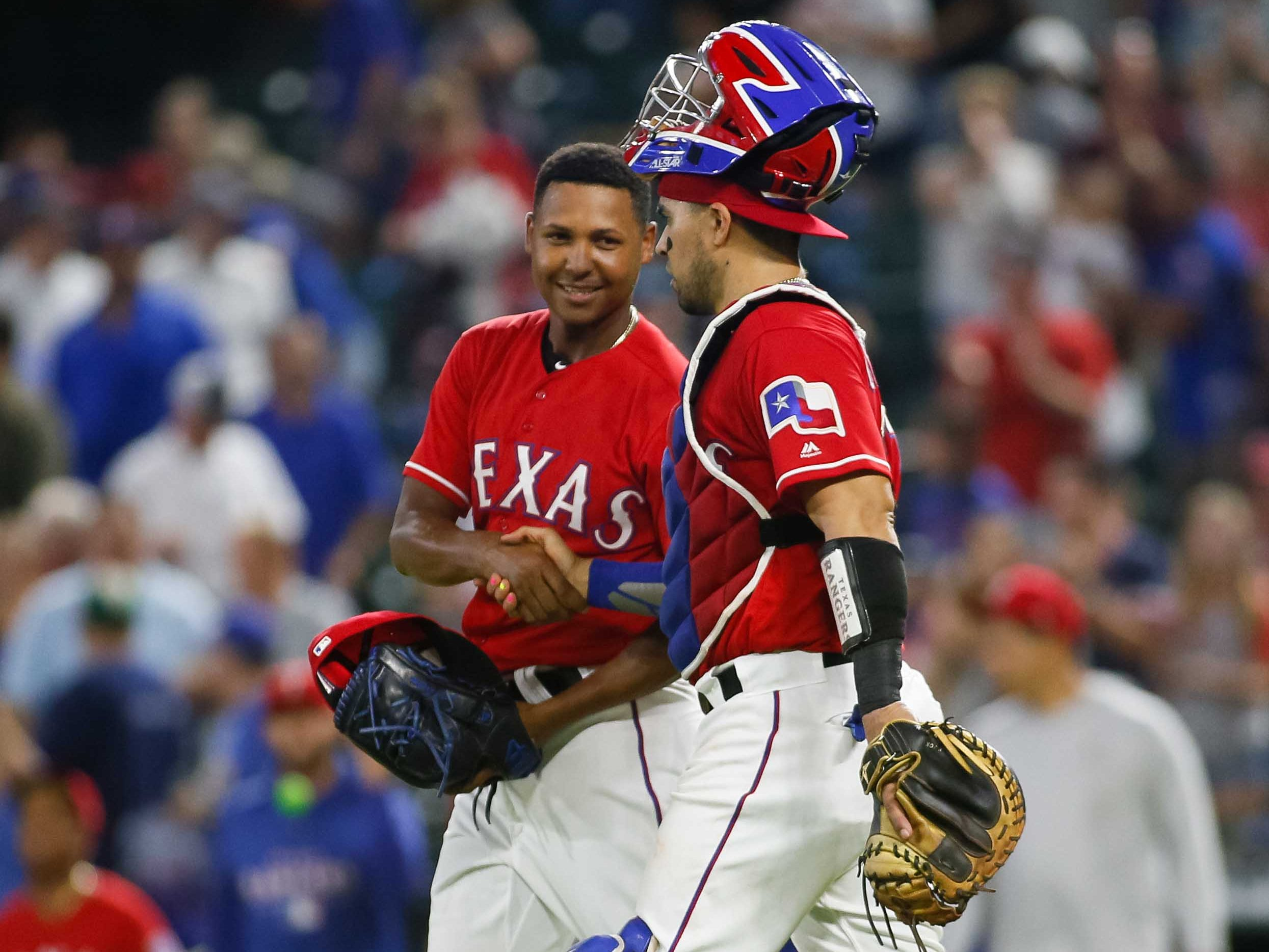 Aug 13, 2018; Arlington, TX, USA; Texas Rangers relief pitcher Jose Leclerc (62) and catcher Robinson Chirinos (61) react following the game against the Arizona Diamondbacks at Globe Life Park in Arlington. Mandatory Credit: Ray Carlin-USA TODAY Sports